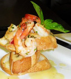 Toasted Bread topped with Sauteed Shrimp with a White Wine Lemon Butter sauce