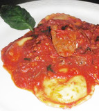 Three Cheese Ravioli topped with slices of Spicy Italian Sausage and Marinara sauce.