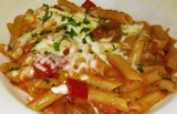 <p>Penne pasta tossed in Marinara sauce, Italian sausage, and Bell Peppers, then smothered in melted Mozzarella cheese. (*spicy)</p>