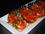 Toasted bread topped with diced tomatoes, Basil, Garlic, and drizzled with Olive oil.