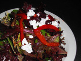 <p>Mixed greens tossed in a Rasberry Vinaigarette topped with Goat cheese and roasted red peppers.</p>